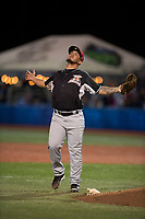 Salem-Keizer Volcanoes relief pitcher Jesus Tona (48) celebrates as he walks off the field between innings of a Northwest League game against the Hillsboro Hops at Ron Tonkin Field on September 1, 2018 in Hillsboro, Oregon. The Salem-Keizer Volcanoes defeated the Hillsboro Hops by a score of 3-1. (Zachary Lucy/Four Seam Images)