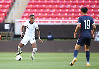 ZAPOPAN, MEXICO - MARCH 21: Andres Perea #15 of the United States dribbles the ball during a game between Dominican Republic and USMNT U-23 at Estadio Akron on March 21, 2021 in Zapopan, Mexico.