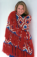 Christie Brinkley models crochet winter fashion pieces, 1975. Photo by John G. Zimmerman.