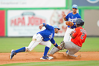 Cristian Moronta (2) of the Greeneville Astros slides into second base ahead of the tag by Burlington Royals shortstop Ramon Torres (25) at Burlington Athletic Park on July 1, 2013 in Burlington, North Carolina.  The Astros defeated the Royals 8-1 in Game Two of a doubleheader.  (Brian Westerholt/Four Seam Images)