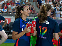 HOUSTON, TX - JUNE 13: Alex Morgan #13 of the USWNT holds BioSteel bottles for her teammates before a game between Jamaica and USWNT at BBVA Stadium on June 13, 2021 in Houston, Texas.