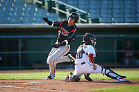 Lake Elsinore Storm Tirso Ornelas (23) slides around catcher Austin Bernard (10) to score a run during a California League game against the Lancaster JetHawks on April 10, 2019 at The Hanger in Lancaster, California. Lake Elsinore defeated Lancaster 10-0 in the first game of a doubleheader. (Zachary Lucy/Four Seam Images)