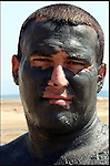 A man covered in rejuvenating mineral mud  is seen at Ein Gedi Spa at the Dead Sea in southern Israel, where the now-distant shoreline can be seen about a kilometer away. The inland sea which separates between Israel and Jordan is retreating by about a meter a year as the two countries divert almost 90% of the Jordan River waters that for thousands of years fed the mineral-rich sea. They are now seeking international support for a plan to pipe water north from the Gulf of Aqaba to the Dead Sea to rescue the shrinking sea. Photo by Quique Kierszenbaum