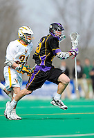 10 April 2011: University at Albany Great Dane midfielder Keith Olson, a Junior from Columbus, Ohio, in action against the University of Vermont Catamounts on Moulton Winder Field in Burlington, Vermont. The Catamounts defeated the visiting Danes 11-6 in America East play. Mandatory Credit: Ed Wolfstein Photo