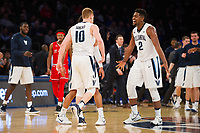 NEW YORK, NY - Thursday March 9, 2017: Kris Jenkins (#2) of Villanova, Donte DiVincenzo (#10) of Villanova and teammates celebrate their big lead over St. John's as the two schools square off in the Quarterfinals of the Big East Tournament at Madison Square Garden.