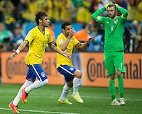 Neymar of Brazil celebrates scoring a penalty goal after making it 2-1