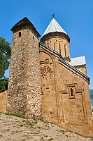 Pictures & images of the Church of the Assumption built in 1689. and a a tower with a stepped pyramidal roof of Svanetian type,  Ananuri castle complex & Georgian Orthodox churches, 17th century, Georgia (country).<br /> <br /> Ananuri castle is situated next to the Military Road overlooking the Aragvi River in Georgia, about 45 miles (72 kilometres) from Tbilisi. It was the castle of the eristavis (Dukes) of Aragvi from the 13th century and was the scene of numerous battles. In 2007 Ananuri castle was enscribed on the   UNESCO World Heritage Site tentative list.