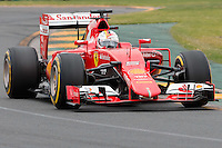 March 14, 2015: Sebastian Vettel (DEU) #5 from the Scuderia Ferrari team rounds turn two during qualification at the 2015 Australian Formula One Grand Prix at Albert Park, Melbourne, Australia. Photo Sydney Low