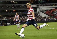 MEXICO CITY, MEXICO - AUGUST 15, 2012:  Brek Shea (11) of the USA MNT sends over the pass that resulted in the USA winning goal against  Mexico during an international friendly match at Azteca Stadium, in Mexico City, Mexico on August 15. USA won 1-0.