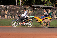 Cambodia, Angkor Thom.  Motorcycle-powered Taxi Passing the Elephant Terrace.