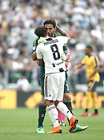 Calcio, Serie A: Juventus - Hellas Verona, Torino, Allianz Stadium, 19 maggio, 2018.<br /> Juventus' Captain and goalkeeper Gianluigi Buffon (l) embraces his teammate Claudio Marchisio (r) as he is substituted off during the during the Italian Serie A football match between Juventus and Hellas Verona at Torino's Allianz stadium, 19 May, 2018.<br /> Juventus won their 34th Serie A title (scudetto) and seventh in succession.<br /> Gianluigi Buffon played his last match with Juventus today after 17 years.<br /> UPDATE IMAGES PRESS/Isabella Bonotto