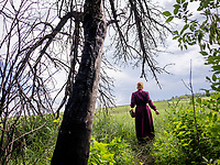 Natalia Voronkova, a volunteer who offers support and basic first aid training for Ukrainian government forces fighting Russian-backed separatists in the east of the country, walks near the frontline positions. The situation is tense here, with mortar attacks and snipers ready to fire at their next target if the soldiers do not stay under cover.<br /><br />Natalia Voronkova says she hasn't worn jeans since 2014, and it's a statement for her to insist on wearing long dresses and high heels, even while walking in the trenches. She believes that her clear civilian appearance will protect her from snipers, but she also thinks that it brings a message of normality to the Ukrainian soldiers. It encourages them to not give up, if she can walk here in such clothes they might also find the strength to carry on under such hard living conditions.