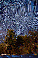 A view of a clear sky and star trails during the winter. Marquette County, Michigan.