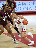Arkansas guard Chelsea Dungee (33) drives through the lane Thursday, Feb. 11, 2021, as Mississippi State center Jessika Carter (4) defends during the first half of play in Bud Walton Arena. Visit nwaonline.com/210212Daily/ for today's photo gallery. <br /> (NWA Democrat-Gazette/Andy Shupe)
