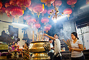 Devout Chinese devotees pray at the Goddess of Mercy temple in the UNESCO heritage city of Georgetown in Penang, Malaysia. Photo: Sanjit Das/Panos