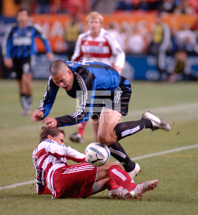 Colorado defender Mike Petke is tackled hard by FC Dallas midfielder Simo Valakari. The Colorado Rapids drew 0-0 with FC Dallas in the first game of the Western Conference Semi-finals Invesco Field at Mile High, Denver, Colorado, September 22, 2005.