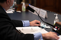 United States Secretary of Veterans Affairs (VA) Robert Wilkie, touches a face mask at a hearing with the US House Appropriations Subcommittee on Military Construction, Veterans Affairs, and Related Agencies on Capitol Hill in Washington DC, on May 28th, 2020.<br /> Credit: Anna Moneymaker / Pool via CNP/AdMedia