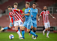 21st April 2021; Bet365 Stadium, Stoke, Staffordshire, England; English Football League Championship Football, Stoke City versus Coventry; Nick Powell of Stoke City is tackled by Kyle McFadzean of Coventry City
