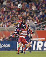 New England Revolution midfielder Shalrie Joseph (21) goes high over FC Dallas midfielder Pablo Ricchetti (6) for a head ball. The New England Revolution defeated FC Dallas, 2-1, at Gillette Stadium on April 4, 2009. Photo by Andrew Katsampes /isiphotos.com