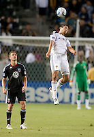 LA Galaxy defender Omar Gonzalez (4) heads the ball during the first half of the game between LA Galaxy and the D.C. United at the Home Depot Center in Carson, CA, on September 18, 2010. LA Galaxy 2, D.C. United 1.