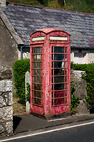 Weathered old English phone booth. Near Cushendall, Northern Ireland