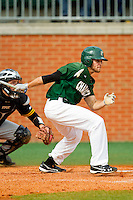Michael Green (3) of the Charlotte 49ers follows through on his swing against the Virginia Commonwealth Rams at Robert and Mariam Hayes Stadium on March 30, 2013 in Charlotte, North Carolina.  The 49ers defeated the Rams 9-8 in game one of a double-header.  (Brian Westerholt/Four Seam Images)