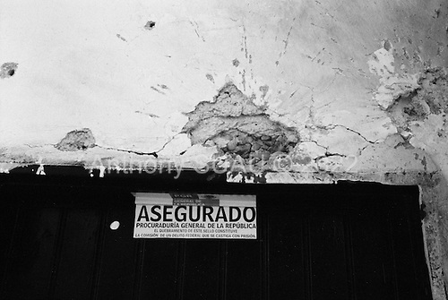 Culiacan, Sinaloa.Mexico.July 4, 2008..After a major shoot-out at a former Narco hold-out in the city center, the house is left abandon and bullet ridden. There were seven federal policemen shot during the May shoot-out. Almost all of the bullet holes are out going - former the Narco members shoot at the police. All of the suspects escaped. From January 1 to mid-July 2008 there have been 535 drug related killings in Sinolao, many of them were police officers..
