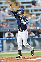 Asheville Tourists designated hitter David Dahl #21 gives thanks after hitting a home run during a game against the Kannapolis Intimidators at McCormick Field on June 5, 2014 in Asheville, North Carolina. The Intimidators defeated the Tourists 5-3. (Tony Farlow/Four Seam Images)