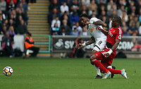 Leroy Fer of Swansea City (R) challenged by a Watford player during the Premier League match between Swansea City and Watford at The Liberty Stadium, Swansea, Wales, UK. Saturday 23 September 2017
