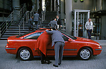 City of London 1992 rich wealthy people new car, yuppie culture outside Lloyds of London Insurance offices. 1990s England
