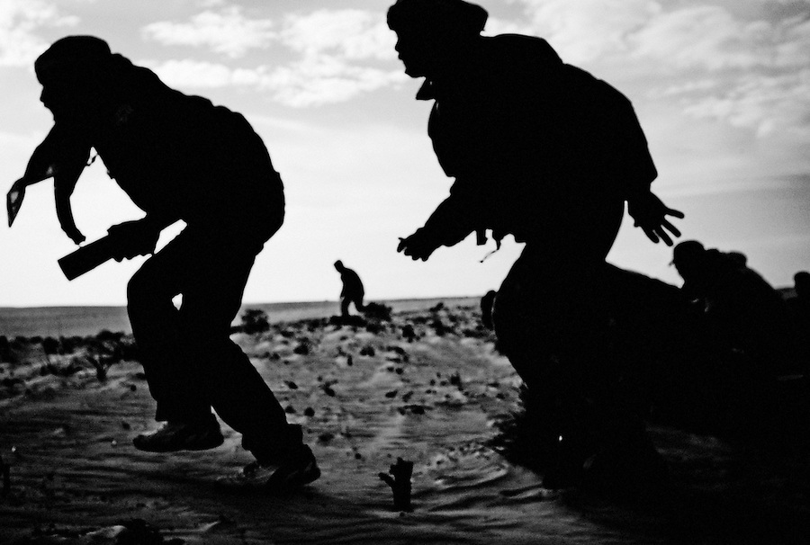Rebel fighters on a recon mission in desert outside of Ajdabiya, Libya.