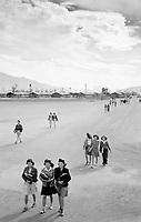internees on their way to school at Manzanar War Relocation Center, Owens Valley, California, 1943.