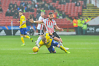Leeds United's midfielder Ezgian Alioski (10) holds onto Sheffield United's defender George Baldock (2) during the Sky Bet Championship match between Sheff United and Leeds United at Bramall Lane, Sheffield, England on 1 December 2018. Photo by Stephen Buckley / PRiME Media Images.