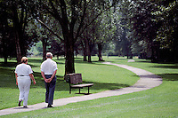 Senior Couple walking on Meandering Path in Burnaby Fraser Foreshore Park along the Fraser River, Burnaby, BC, British Columbia, Canada