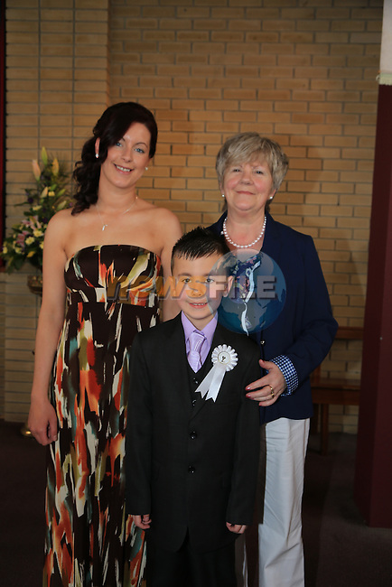 Ryan Healy, Macilla Reilly and Ann Healy.at First Comunion in Holly Family church..Picture:  www.newsfile.ie ..