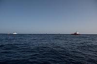Sea Watch-2.<br /> Die Sea Watch-2 bei ihrer 13. SAR-Mission vor der libyschen Kueste.<br /> Im Bild: Die italienische Kuestenwache (links und rechts im Bild) und Schiffe die sich ander Rettung von Gefluechtten beteiligen.<br /> 22.10.2016, Mediterranean Sea<br /> Copyright: Christian-Ditsch.de<br /> [Inhaltsveraendernde Manipulation des Fotos nur nach ausdruecklicher Genehmigung des Fotografen. Vereinbarungen ueber Abtretung von Persoenlichkeitsrechten/Model Release der abgebildeten Person/Personen liegen nicht vor. NO MODEL RELEASE! Nur fuer Redaktionelle Zwecke. Don't publish without copyright Christian-Ditsch.de, Veroeffentlichung nur mit Fotografennennung, sowie gegen Honorar, MwSt. und Beleg. Konto: I N G - D i B a, IBAN DE58500105175400192269, BIC INGDDEFFXXX, Kontakt: post@christian-ditsch.de<br /> Bei der Bearbeitung der Dateiinformationen darf die Urheberkennzeichnung in den EXIF- und  IPTC-Daten nicht entfernt werden, diese sind in digitalen Medien nach §95c UrhG rechtlich geschuetzt. Der Urhebervermerk wird gemaess §13 UrhG verlangt.]