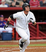 Infielder LB Dantzler (20) of the South Carolina Gamecocks watches his solo home run clear the fence in a game against the Clemson Tigers on March 3, 2012, at Carolina Stadium in Columbia, South Carolina. South Carolina won, 9-6. (Tom Priddy/Four Seam Images)