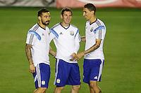 Lionel Messi of Argentina during training with Ezequiel Lavezzi and Angel Di Maria
