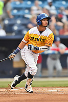 Beer City Tourists center fielder Manny Melendez (19) swings at a pitch during a game against the Lakewood BlueClaws at McCormick Field on June 1, 2017 in Asheville, North Carolina. The Tourists defeated the BlueClaws 8-5. (Tony Farlow/Four Seam Images)