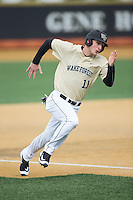 Jonathan Pryor (11) of the Wake Forest Demon Deacons hustles towards home plate against the Harvard Crimson at David F. Couch Ballpark on March 5, 2016 in Winston-Salem, North Carolina.  The Crimson defeated the Demon Deacons 6-3.  (Brian Westerholt/Four Seam Images)