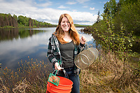 UAA Biology Graduate Student Kelly Ireland with collecting equipment at South Rolly Lake as researchers from UAA, University of Massachusetts Lowell, University of Connecticut, and University of Texas at Austin collaborate on a joint field collection of stickleback fish. The tiny and abundant fish are the subject of intensive study at UAA and elsewhere because of their genetic variability and their surprising physiological parallels with humans.