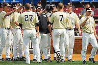Mac Williamson #7 of the Wake Forest Demon Deacons is congratulated by his teammates after hitting his ACC leading 13th home run of the season during the game against the Virginia Tech Hokies at Wake Forest Baseball Park on April 21, 2012 in Winston-Salem, North Carolina.  The Demon Deacons defeated the Hokies 8-6.  (Brian Westerholt/Four Seam Images)