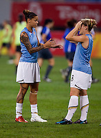 Amy Rodriguez, Natasha Kai. The USWNT defeated New Zealand, 4-0, during the 2008 Beijing Olympics in Shenyang, China.  With the win, the USWNT won group G and advanced to the semifinals.