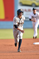 Charleston RiverDogs second baseman Tyler Wade #7 runs to third during a game against the Asheville Tourists at McCormick Field July 29, 2014 in Asheville, North Carolina. The RiverDogs defeated the Tourists 9-3. (Tony Farlow/Four Seam Images)