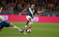 Landon Donovan challenges for a ball..The USA men fell to the Netherlands 2-1 at Amsterdam ArenA, Wednesday, March 3, 2010.