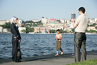 Muslim couple take a photo by the Golden Horn, Istanbul, Turkey