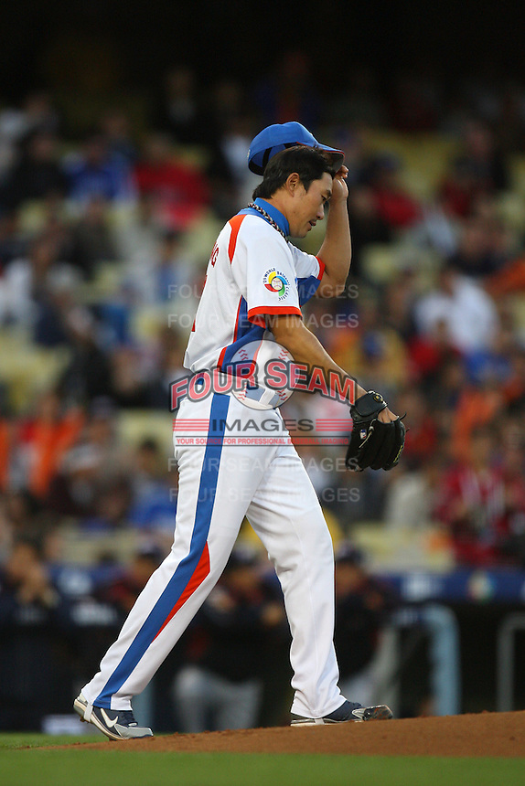 Jungkeun Bong of Korea during a game against Japan at the World Baseball Classic at Dodger Stadium on March 23, 2009 in Los Angeles, California. (Larry Goren/Four Seam Images)