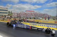 May 20, 2012; Topeka, KS, USA: NHRA top fuel dragster driver Antron Brown (near lane) races alongside Doug Kalitta during the Summer Nationals at Heartland Park Topeka. Mandatory Credit: Mark J. Rebilas-