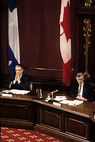 1990 File Photo - Quebec (Qc) CANADA :  Michel Belanger (L) and Jean Campeau (R)  at the Belanger-Campeau Commission hearing in the National Assembly Salon Rouge.<br /> <br /> <br /> Belanger-Campeau Commissioní (formally known as the Commission on the Political and Constitutional Future of Quebec), on the initiative of Premier Robert Bourassa. Its mandate was to examine the political and constitutional status of Quebec and to make recommendations for change in a report to the National Assembly no later than 28 March 1991. Its work proceeded concurrently with, but was entirely separate from, that of the Quebec Liberal Partyís constitutional committee headed by Jean Allaire (see Allaire Report).