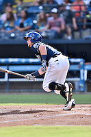 Asheville Tourists shortstop Brendan Rodgers (1) swings at a pitch during a game against the Augusta GreenJackets at McCormick Field on August 6, 2016 in Asheville, North Carolina. The GreenJackets defeated the Tourists 11-4. (Tony Farlow/Four Seam Images)